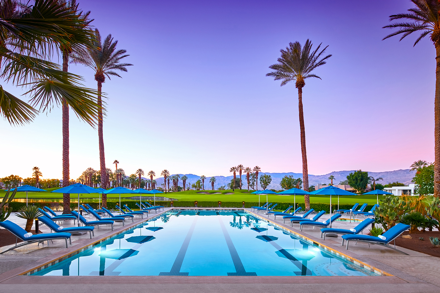 Enjoy a beautiful desert sunset while lying out by the resort's stunning pool.