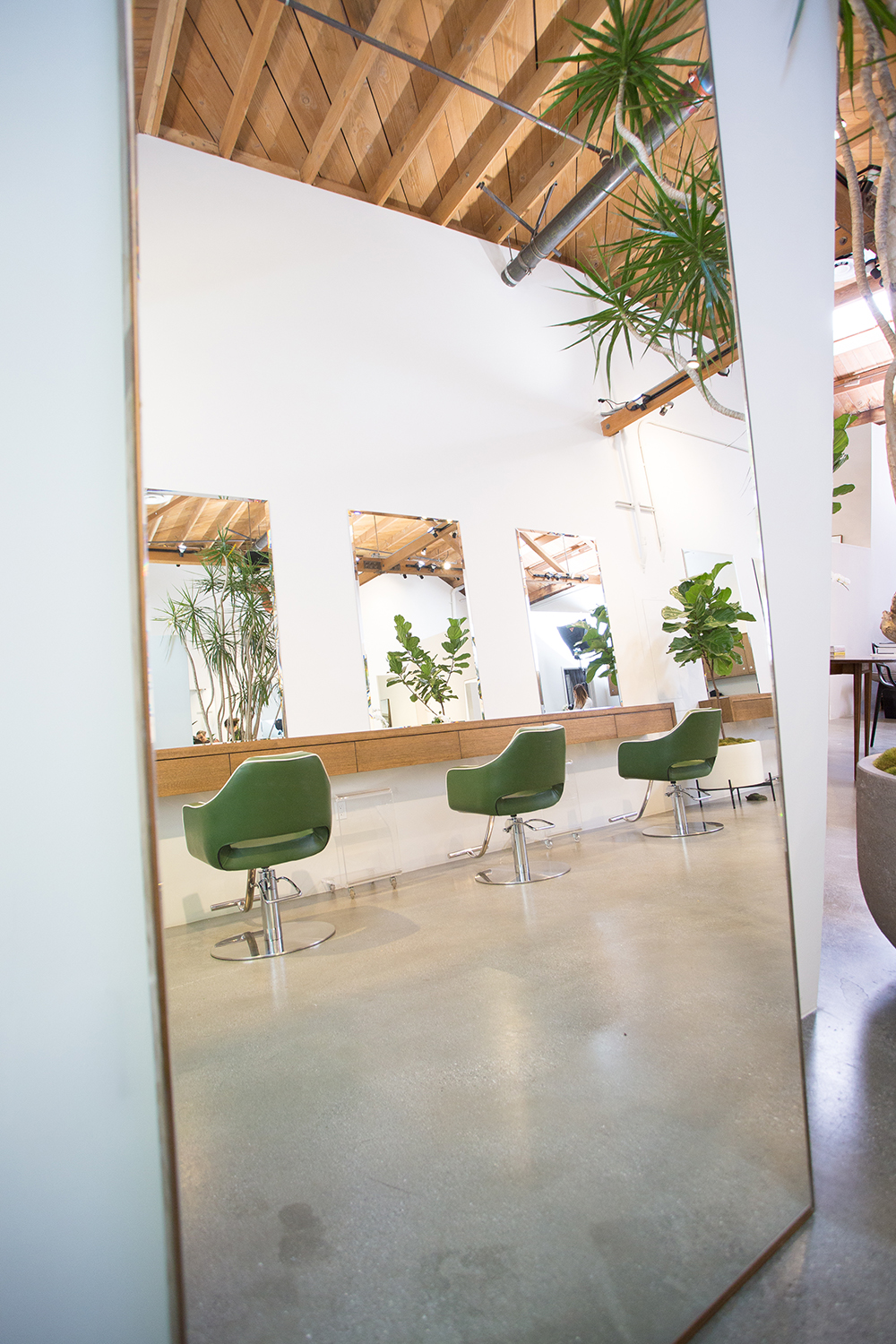 The salon's chic design features lots of natural light and open space.