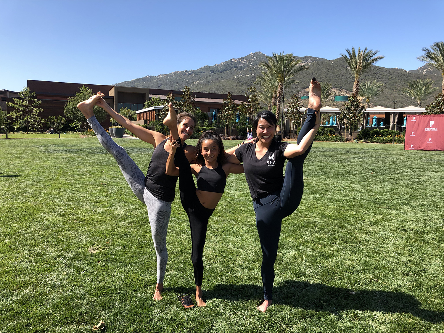 Pechanga's fitness coordinator, yoga and circuit training instructor Mimi Ko (right) with yoga participants.