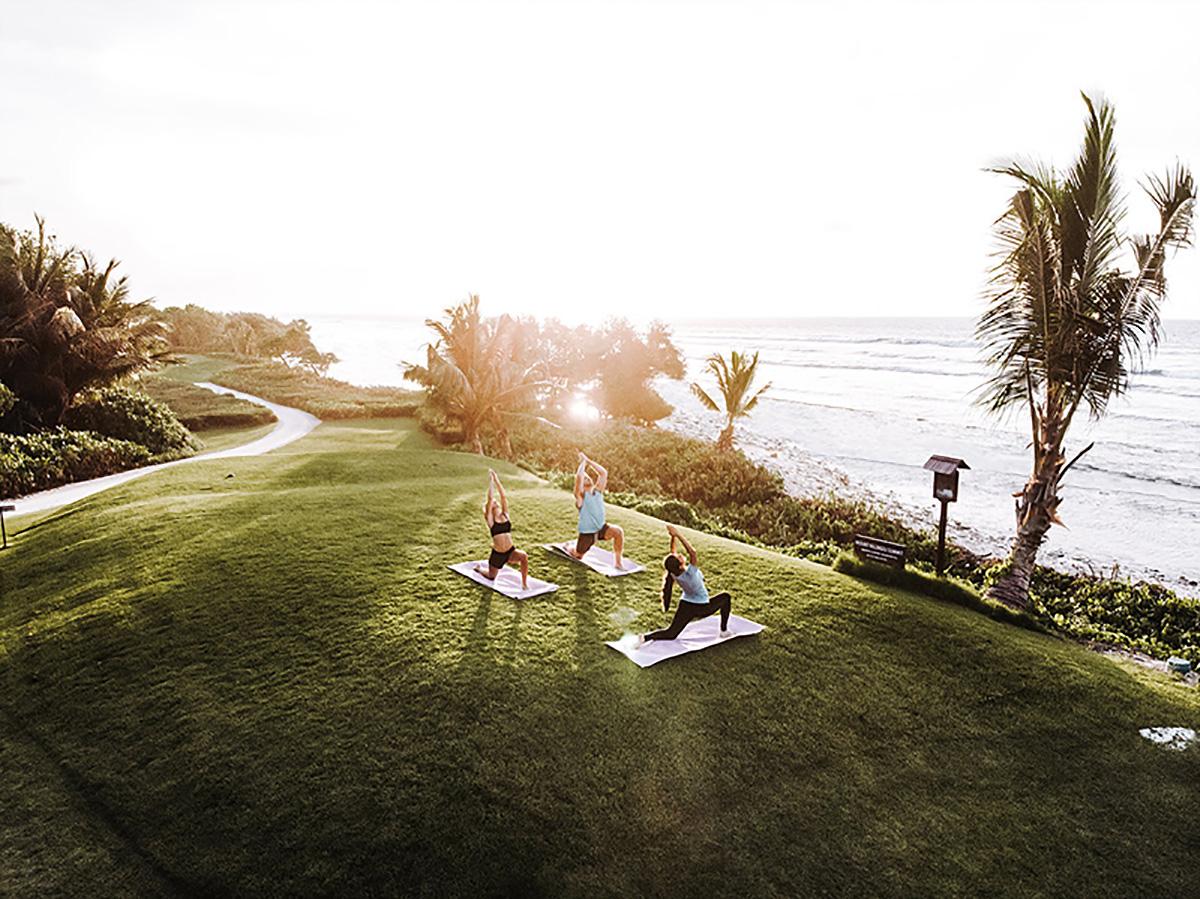 Oceanfront yoga at Shangri-La's Villingili Resort & Spa, Maldives.