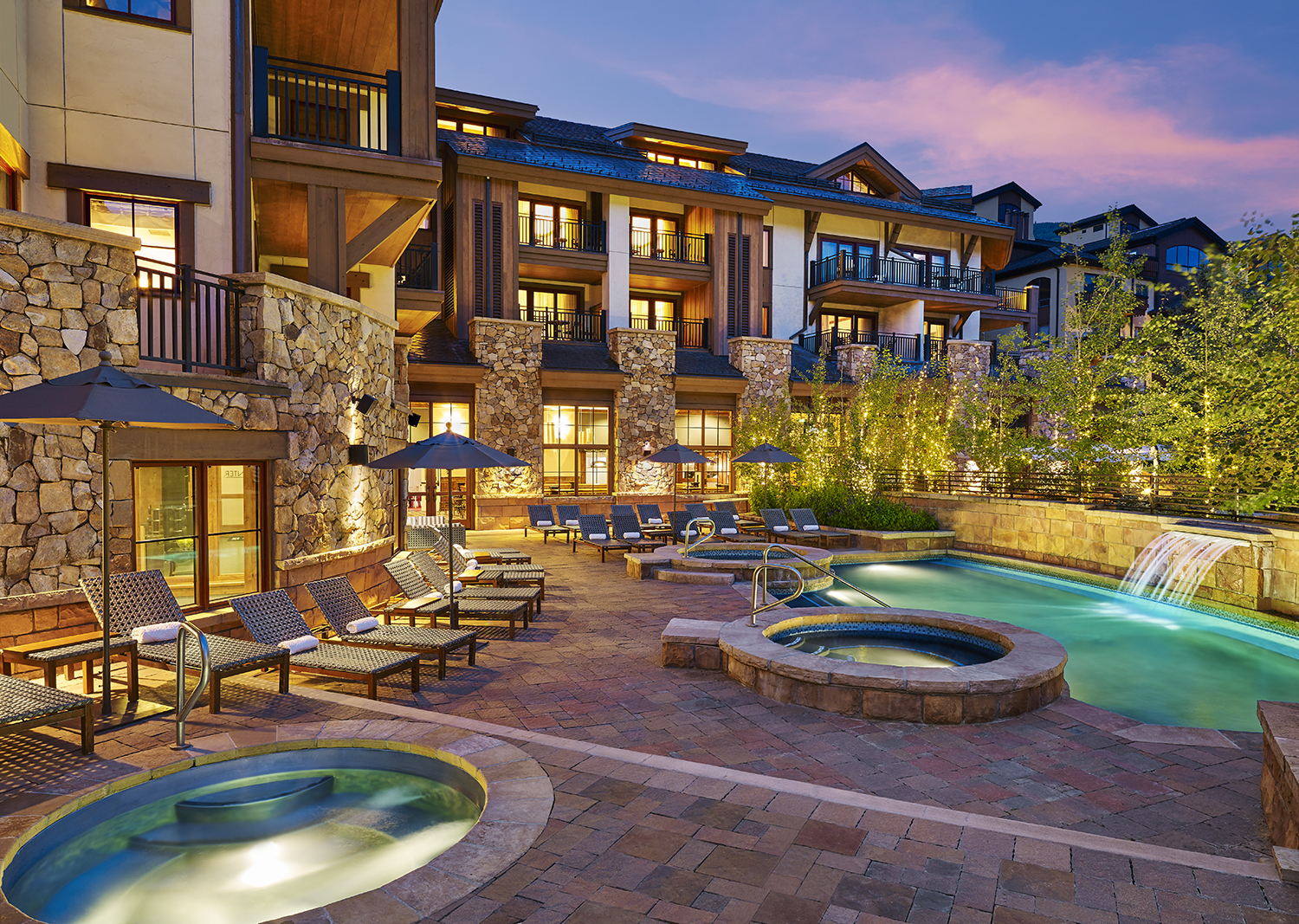 The swimming pool offers stunning mountain views.