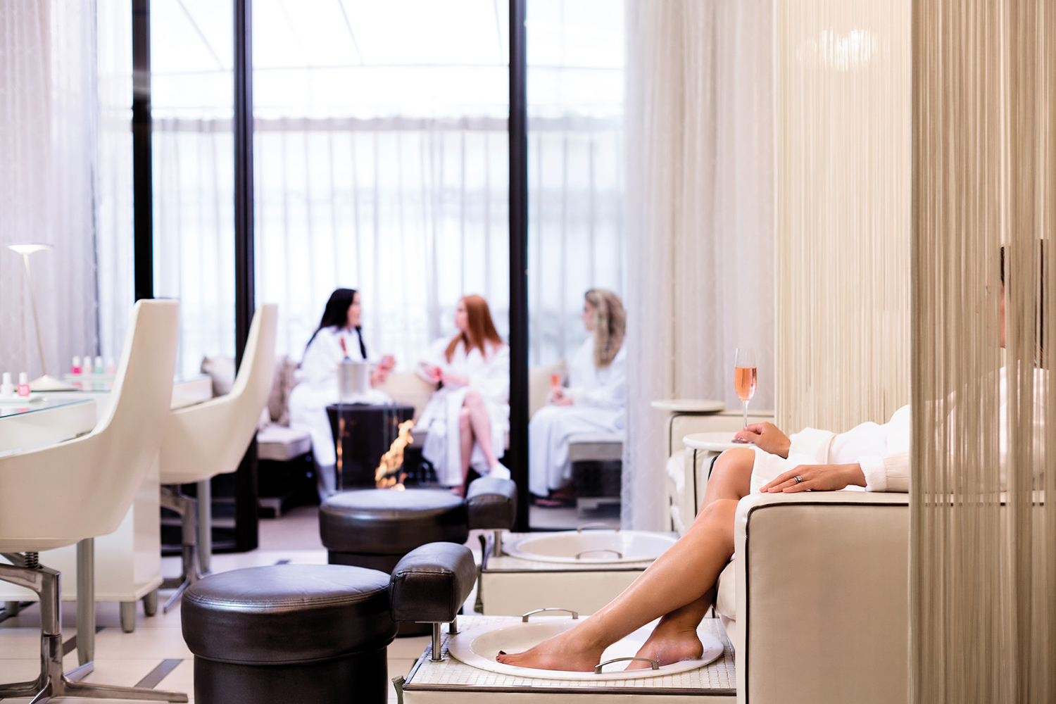 A guest relaxes while receiving a pedicure.