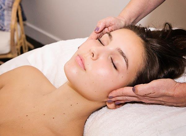 A guest receives a facial at Body Essentials.