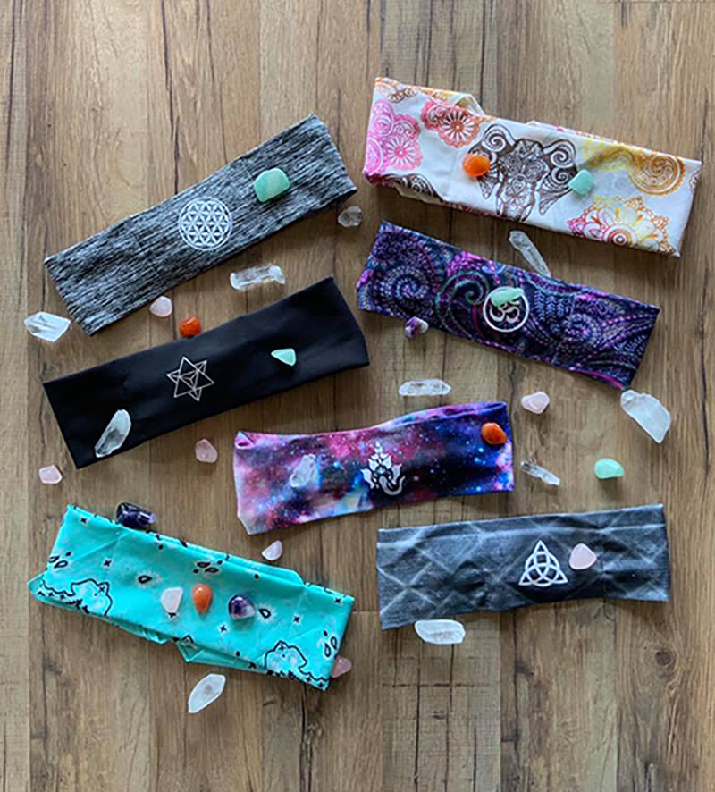 Buddha Gear Buddha Bands ($16.95) are fashion and function with moisture wicking fabric and a hidden pocket for crystals.