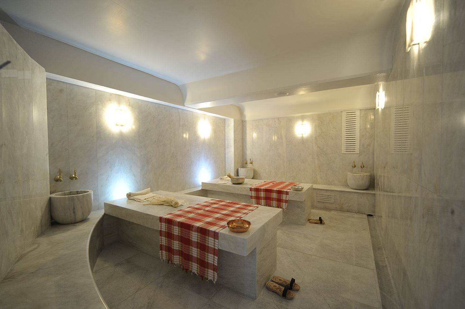 Adjacent to the Hammam bathing area is a treatment area with two marble tables used for body treatments and massages. [Image courtesy of Hammam Bathing House Athens]