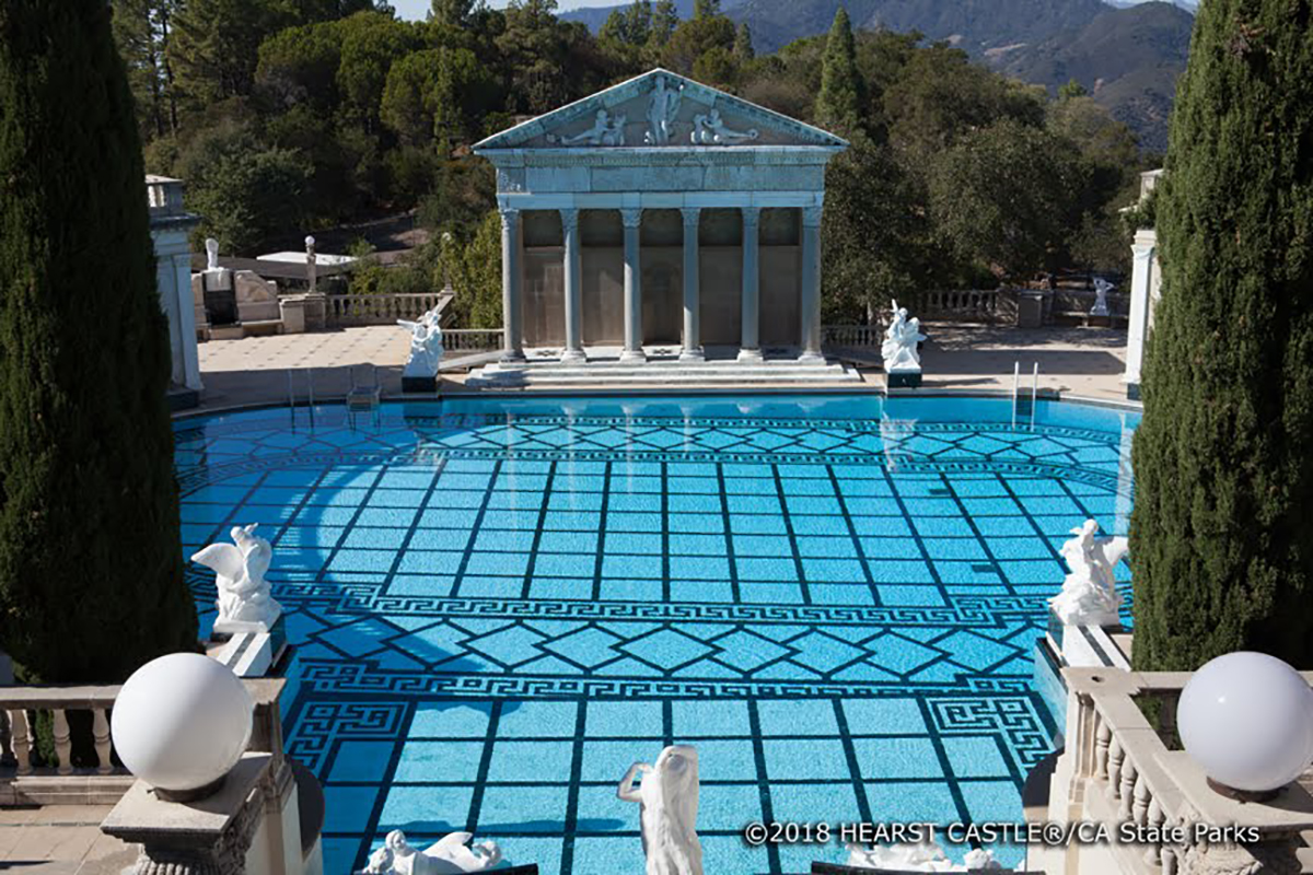 Other notable aspects of the Neptune Pool include the oil-burning heating system, the Vermont marble that lines the basin, gutters, and alcove, and four Italian relief sculptures on the sides of the colonnades.