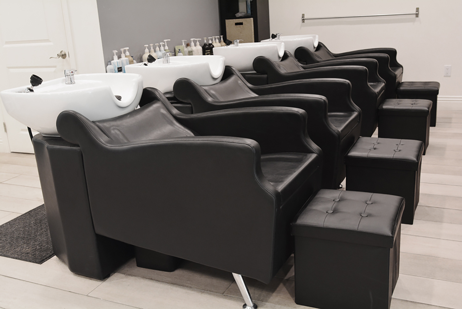 The two-story salon includes a VIP room, facial services, nail services, and more.