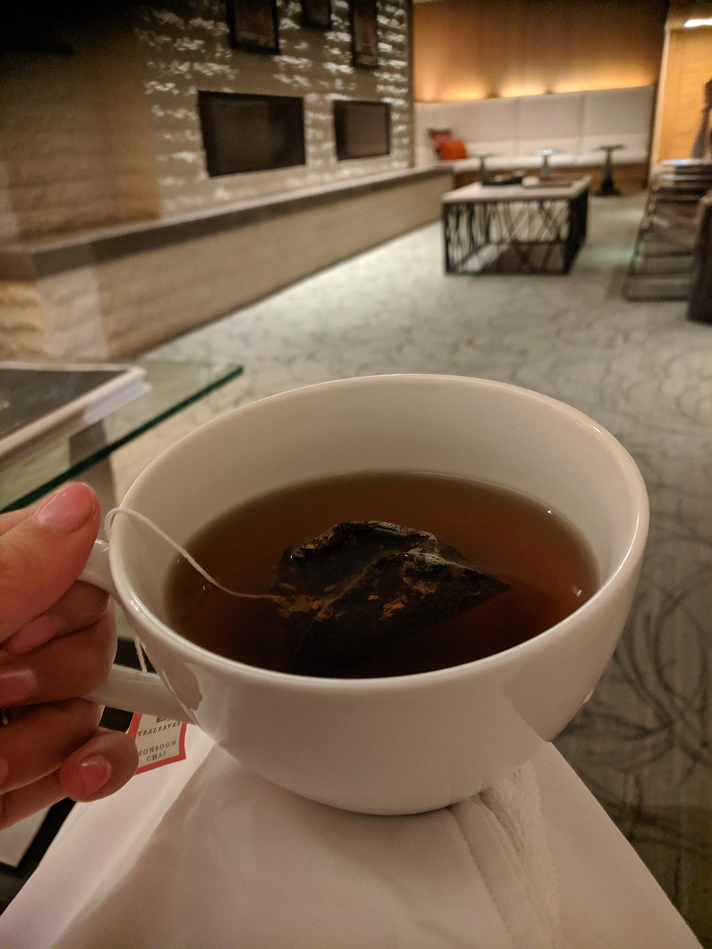 Sipping tea before my spa treatment.