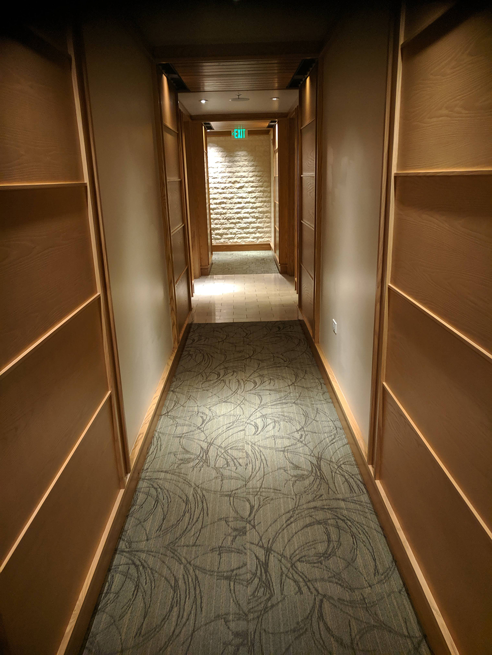 The hallway leads to 15 treatment rooms.