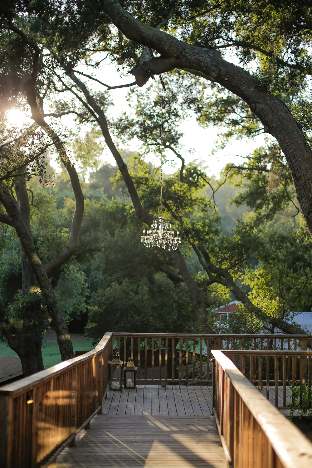 A chandelier hangs up a walkway at Calamigos Guest Ranch & Beach Club.