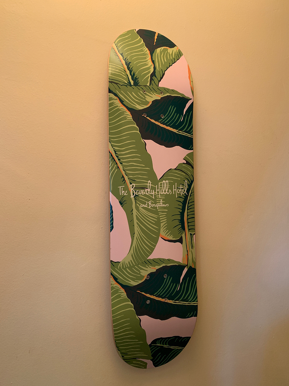 A Beverly Hills Hotel skateboard on display in the hallway.