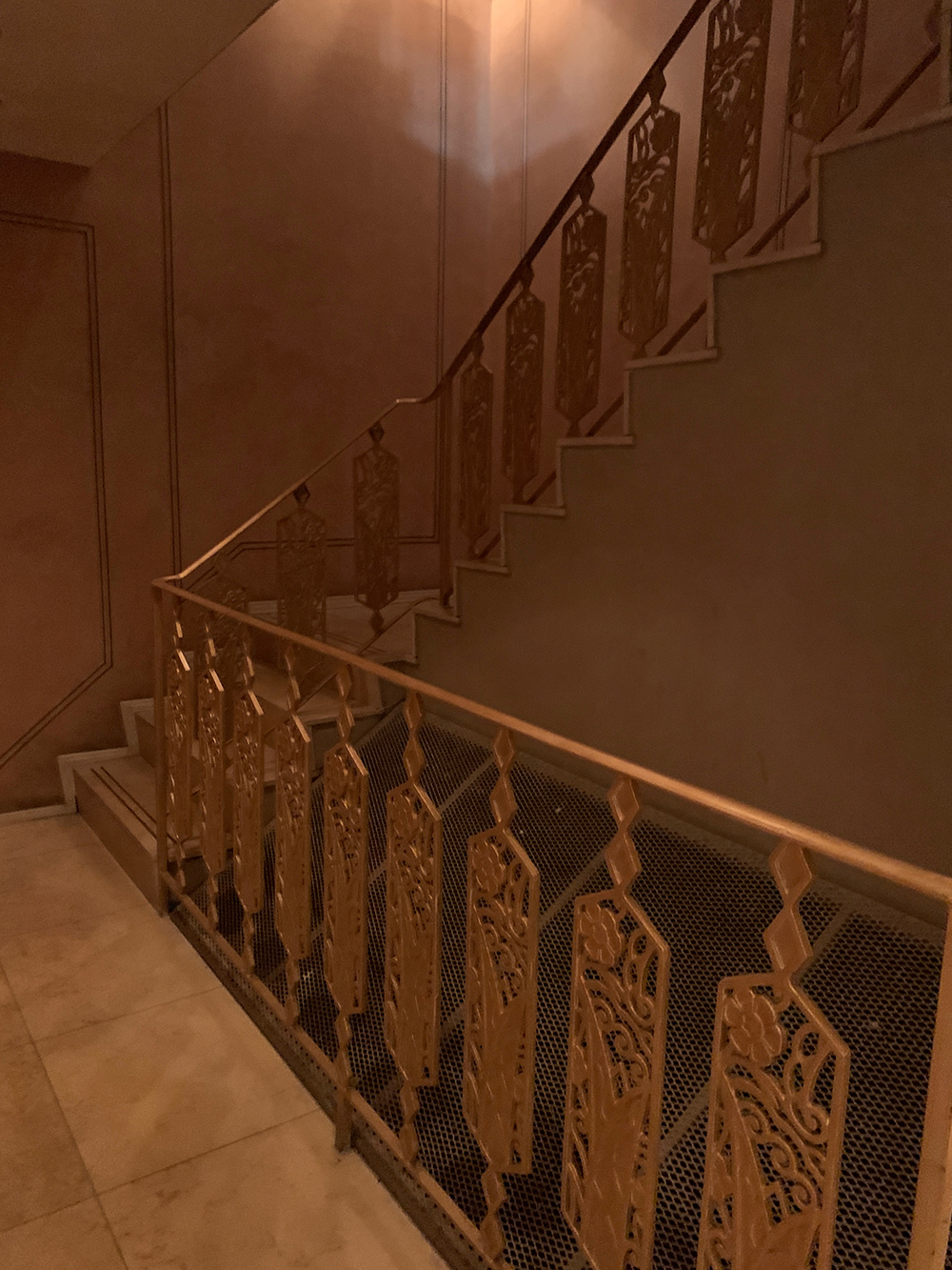 The stylish staircase leading down to the spa.