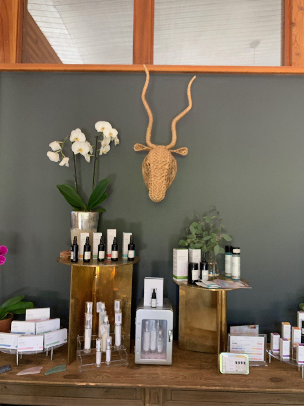 One of the spa's retail displays with various skincare and beauty products.