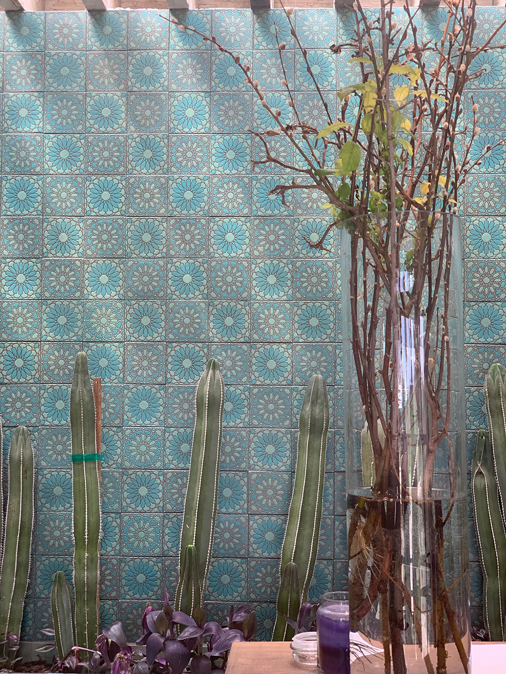 The beautiful tile wall behind the check-in desk.
