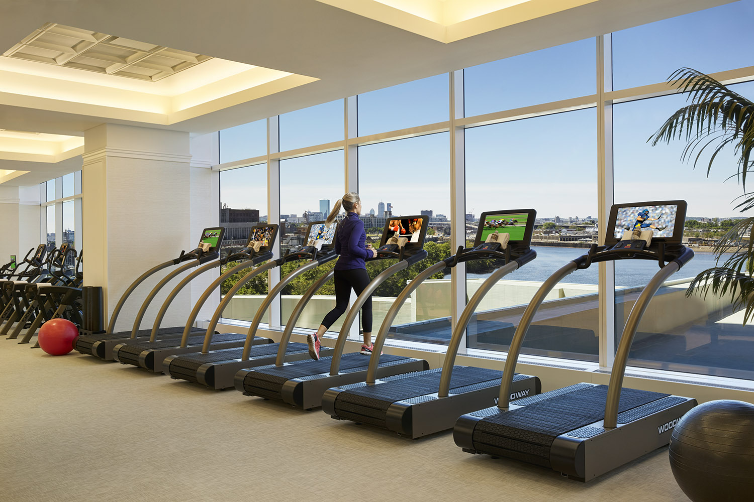 The fitness center offers stunning views.