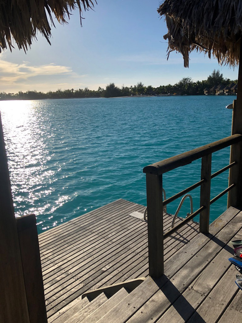 Our private deck with an outdoor shower and lagoon views with water access.