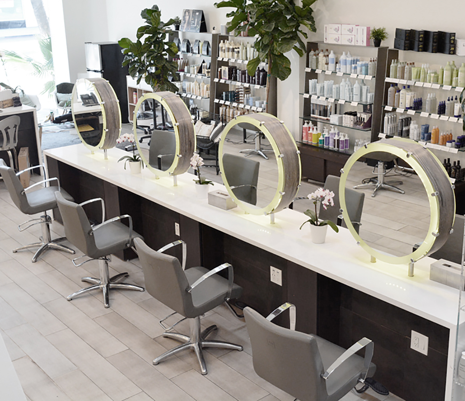 Downstairs there are 18 hair stations, while upstairs hosts an additional four hair stations, a nail station, a skincare service room, and a VIP service room.