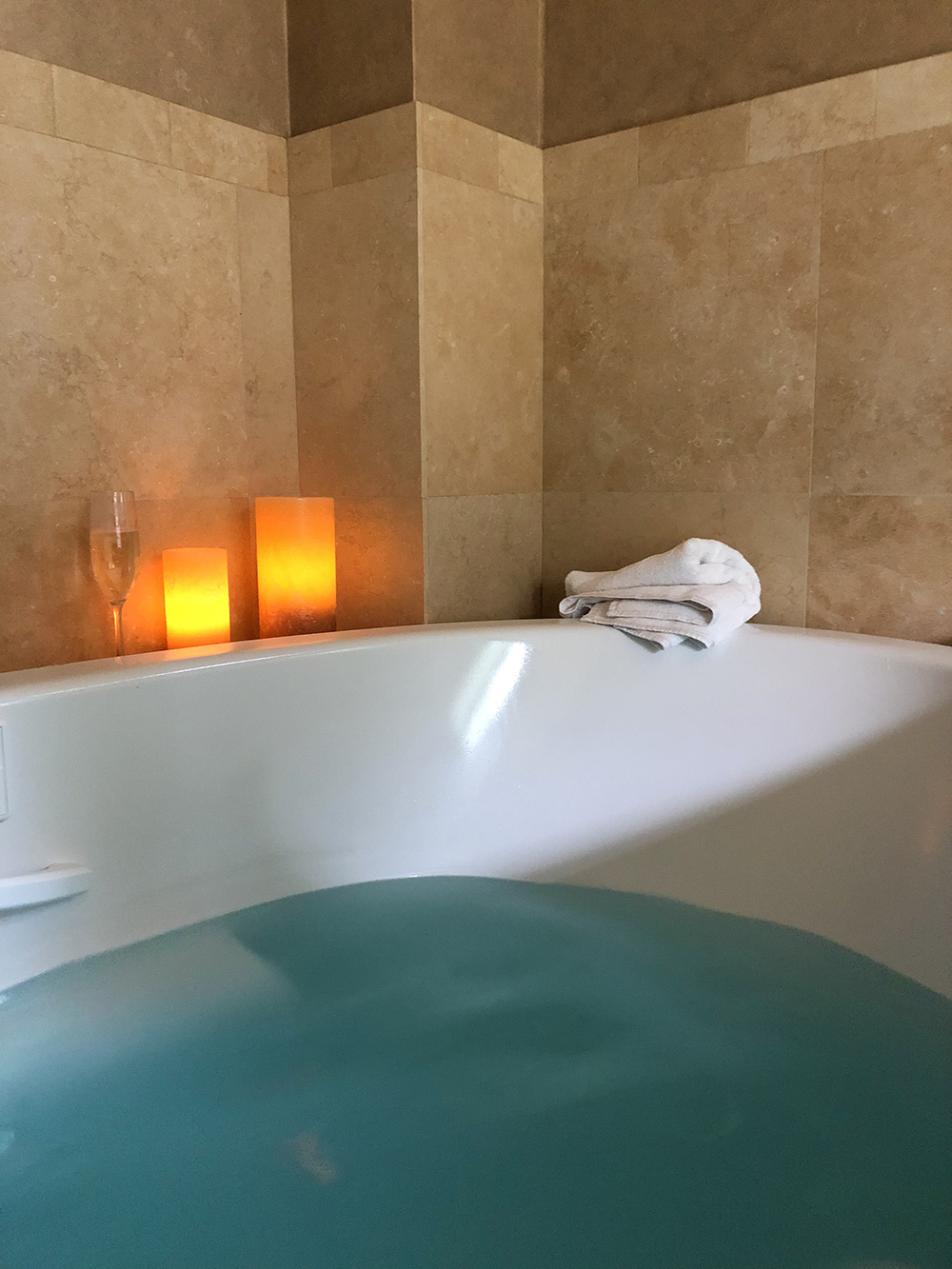 The bath accompanied by champagne and relaxing lighting.
