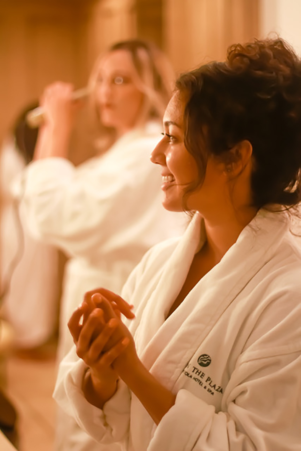 Guests relax in comfortable robes during their spa visit.