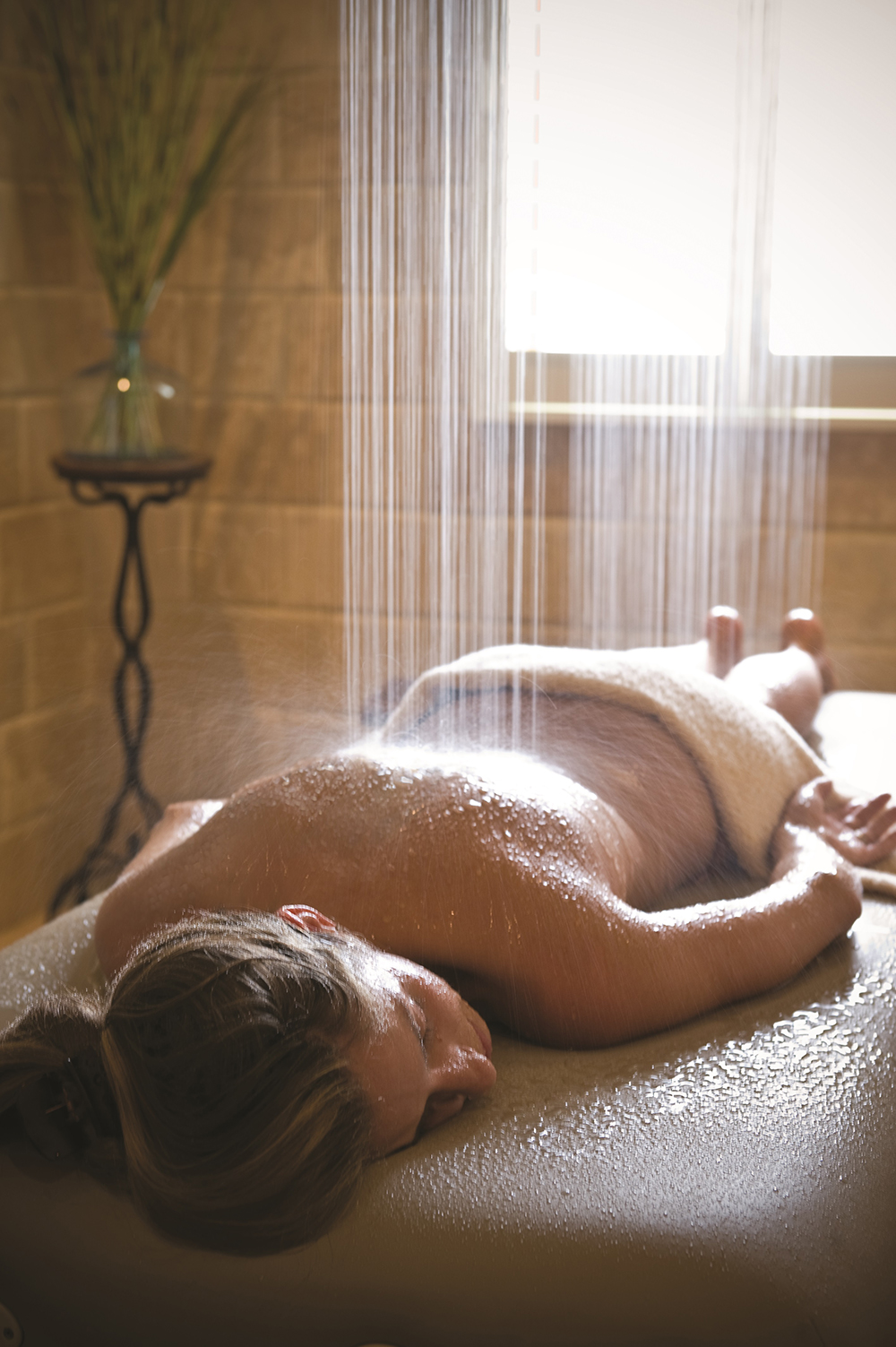 All of the spa's Body Indulgence treatments include a refreshing Vichy water massage.
