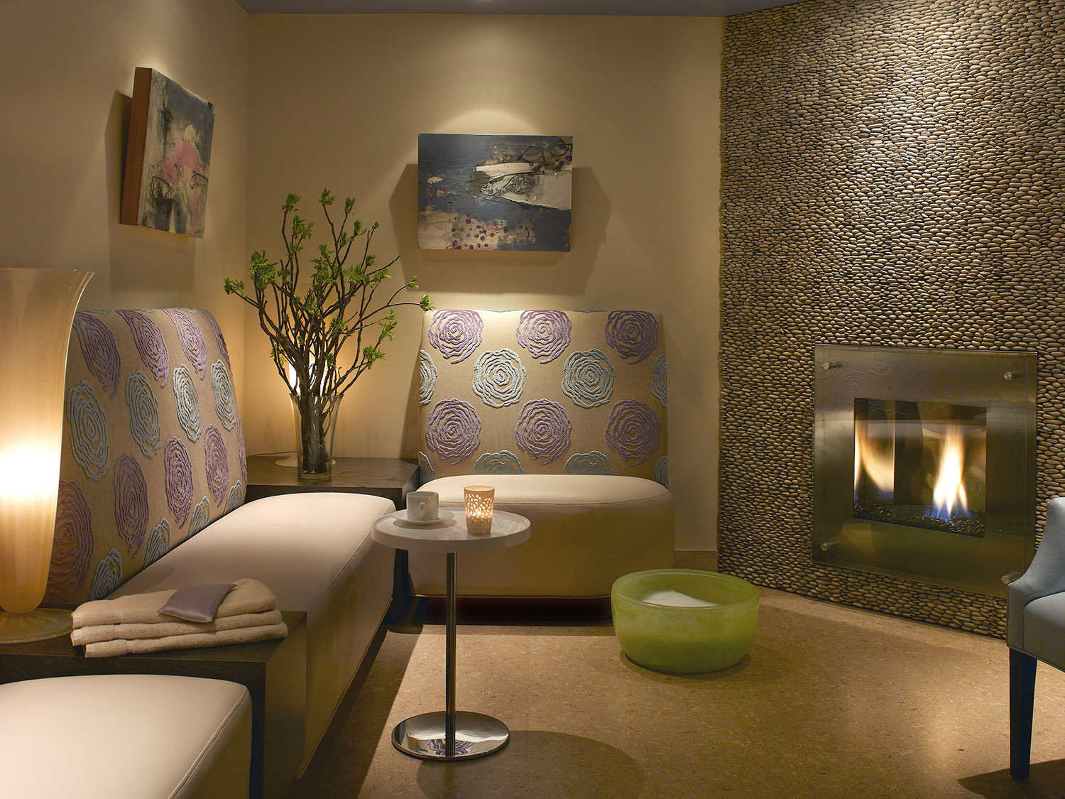 Guests can relax by the fireplace and enjoy a foot soak at both locations (Town & Country location pictured).