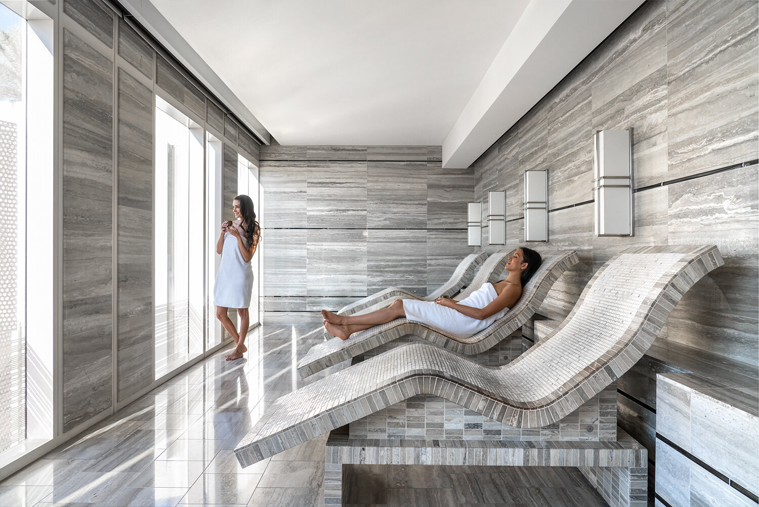 The spa's relaxation spaces include Tepidarium lounges.