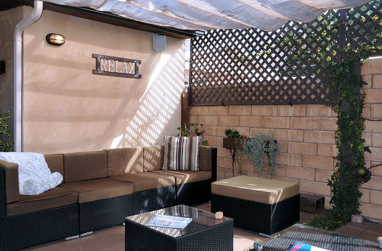 The spa has a garden patio where guests can relax before or after services.