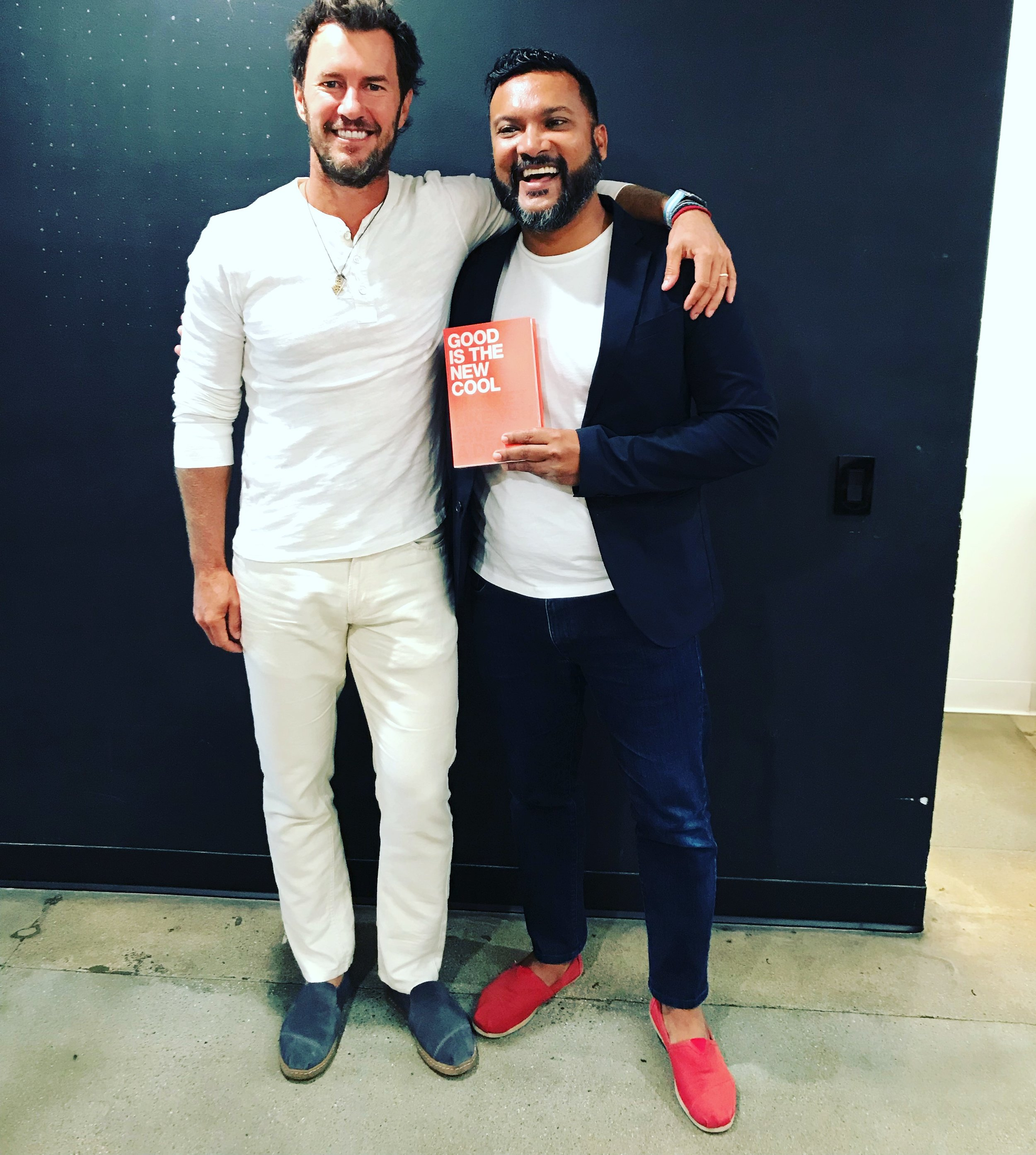 Afdhel with Tom's Shoes Founder Blake Mycoskie (wearing the pair of red Tom's Shoes he got married in).