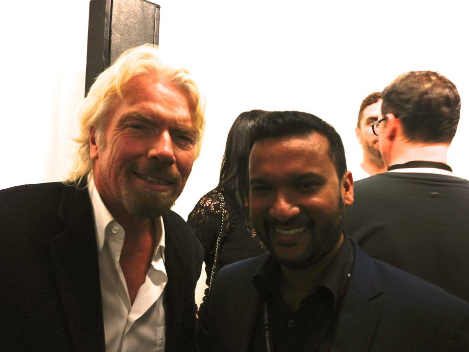 Afdhel meeting one of his heroes, Sir Richard Branson at the C2 Montreal Conference.