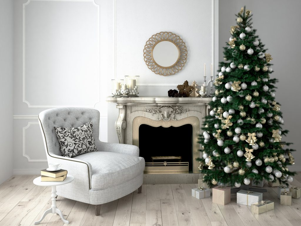 christmas tree with white and gold decorations in light room
