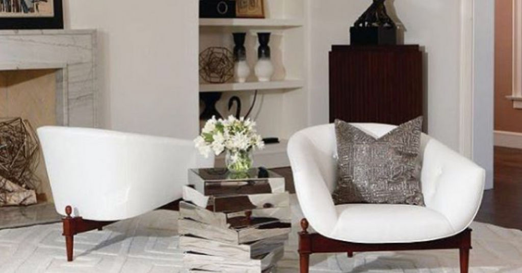 White chair with decorative pillow