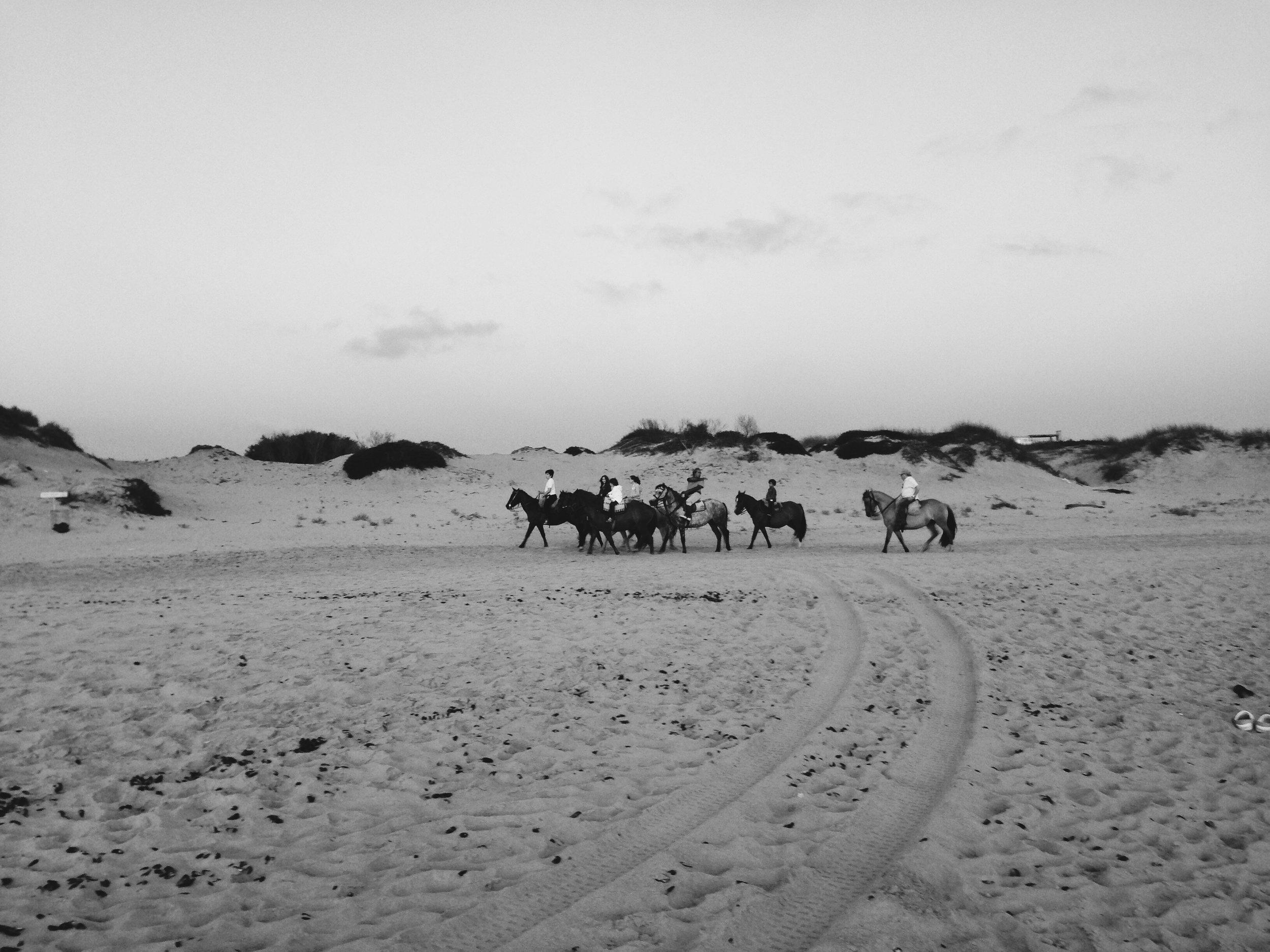 Riders at dusk on Playa Mansa