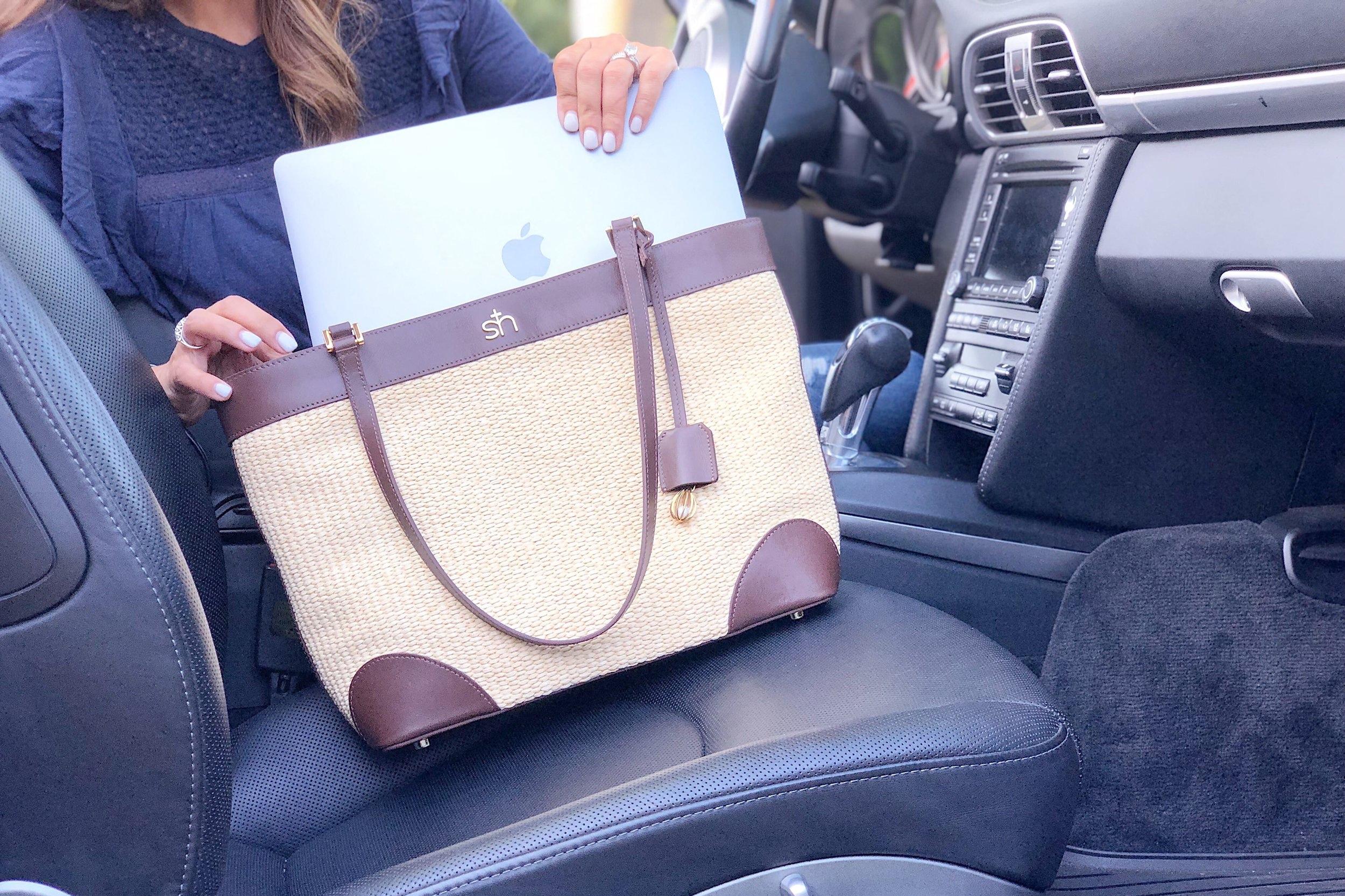 My 13-inch laptop fits easily inside the handbag.