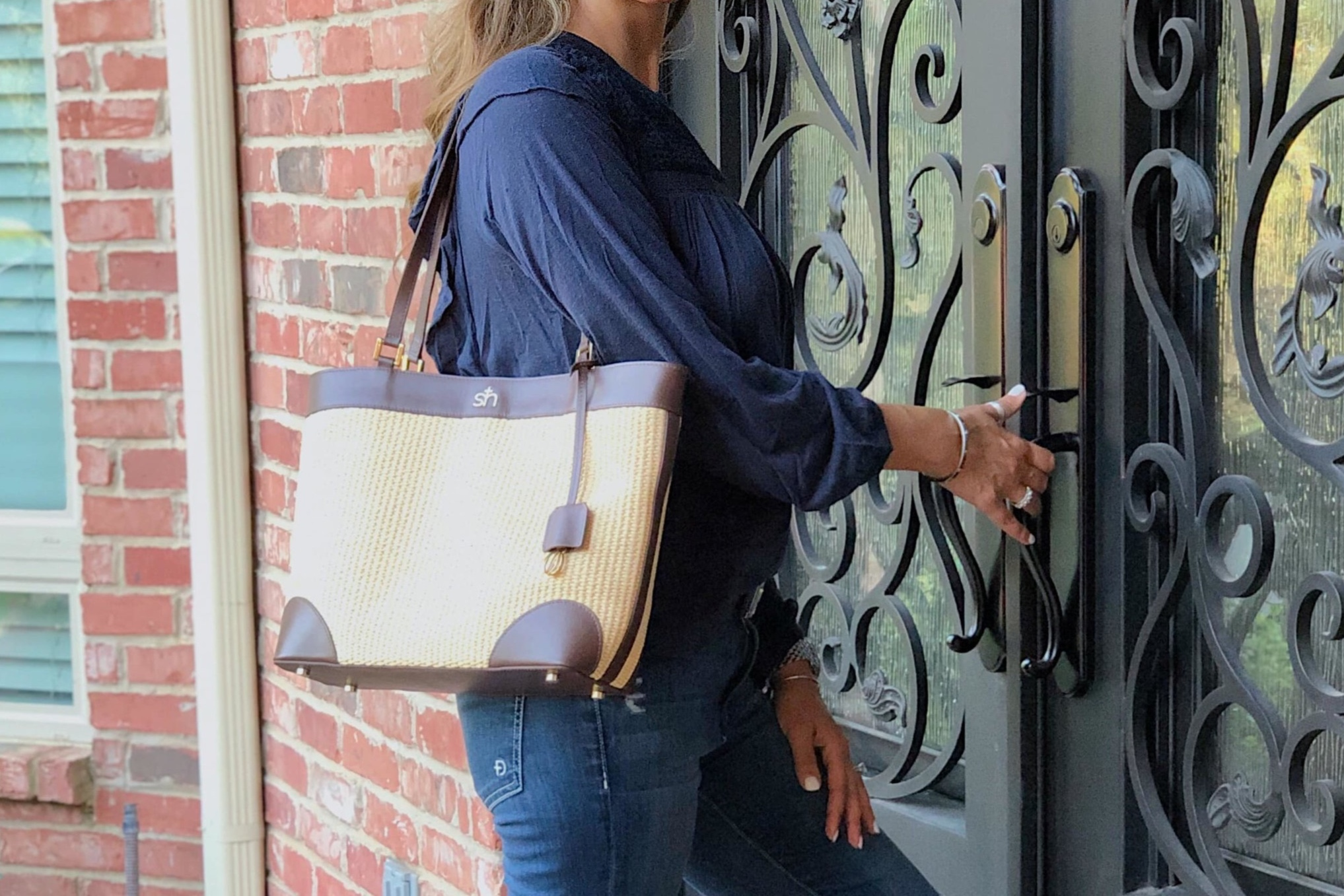 The handles on the    Swatzell + Heilig    handbag make carrying it on your shoulder a breeze.