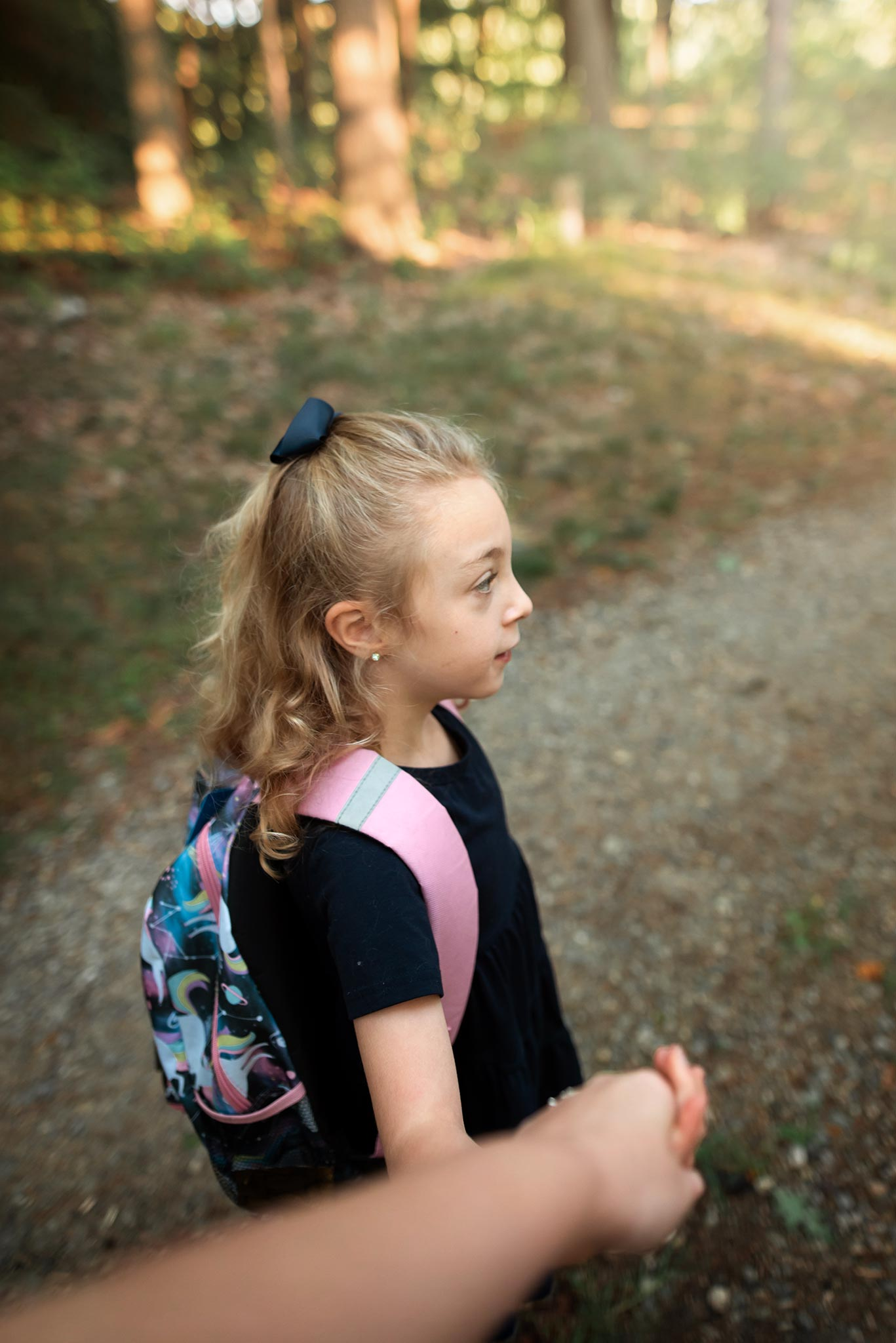 7:51 am… Walking Charlotte to the bus. 24mm, ISO 400, f 2.2, 1/250s