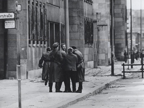 "Late August 1961. An East Berliner is seized by the East German police as he attempts to escape to the West. From the booklet "" A City Torn Apart: Building of the Berlin Wall ."""