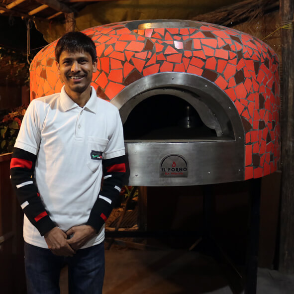 Ramesh in front of the  Il Forno By Marco  oven.