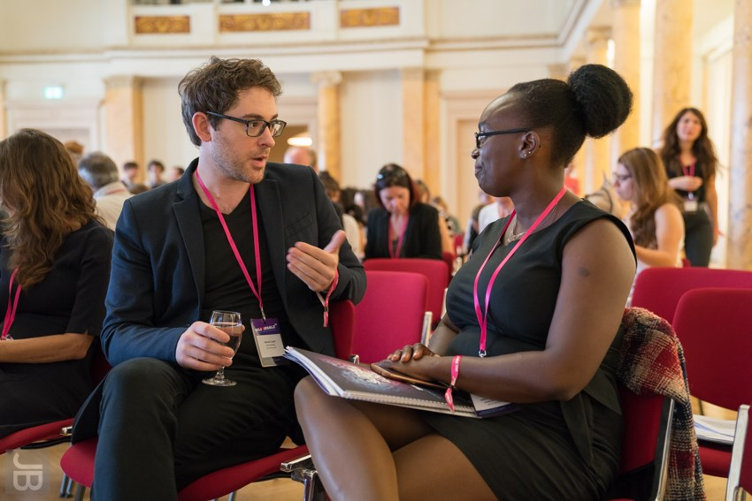 Brian D. Earp and Emily Ngubia Kessé in conversation before their Ignite Talks. Photo:  Joachim Blobel