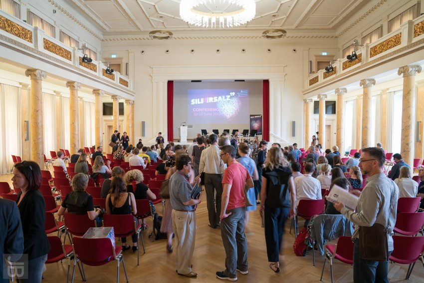 Conference participants mingle after an action-packed first day. Photo:  Joachim Blobel