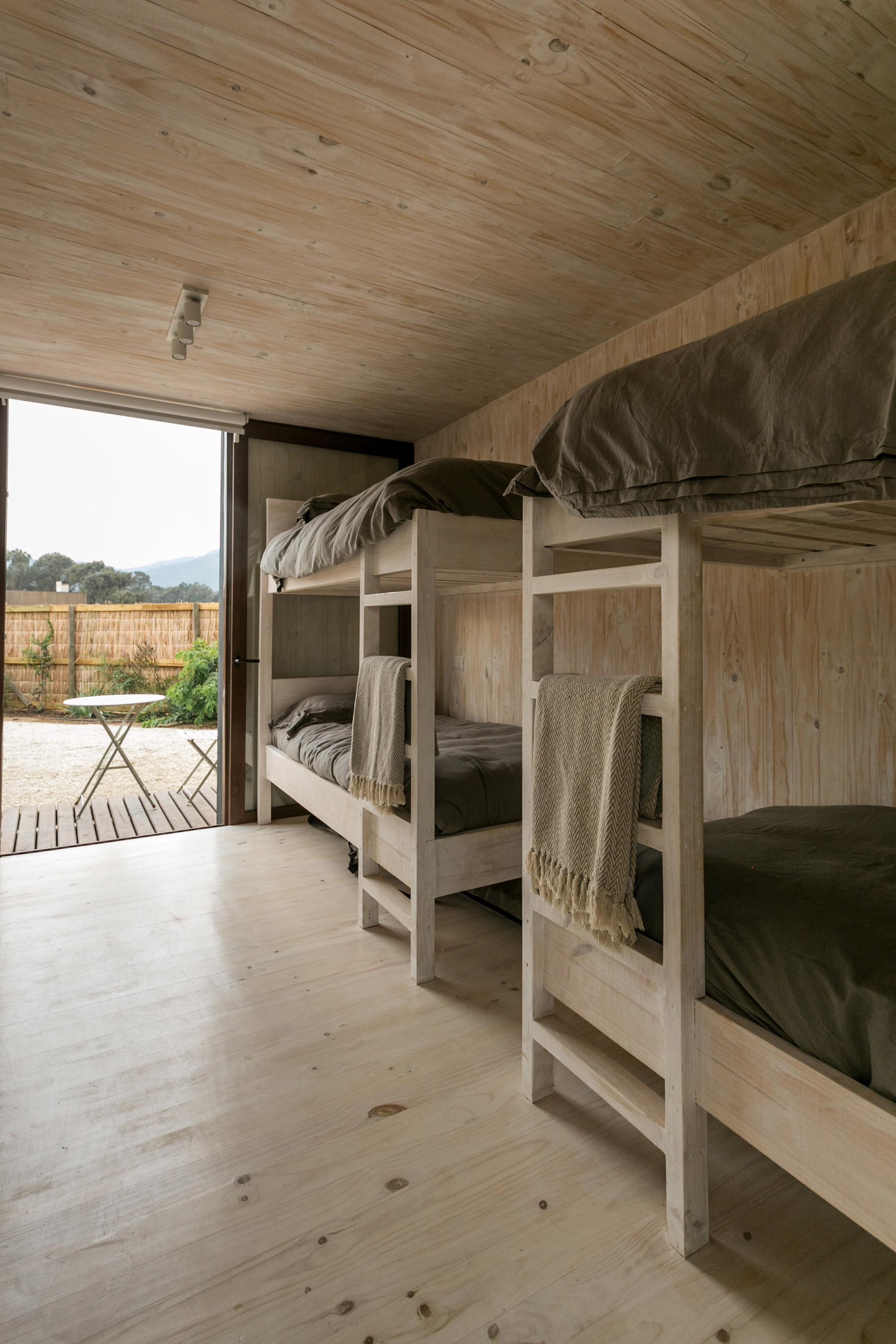 shotgun-house-alejandro-soffia-architecture-black-wood-chile_dezeen_2364_col_8.jpg