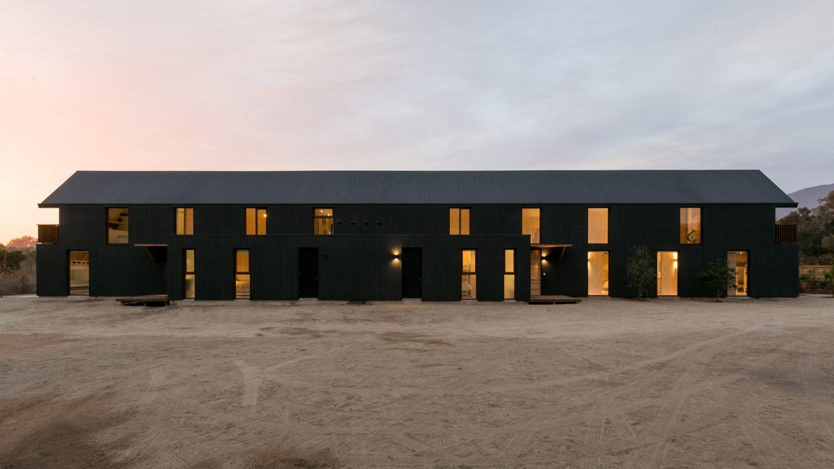 shotgun-house-alejandro-soffia-architecture-black-wood-chile_dezeen_2364_hero-1704x959.jpg