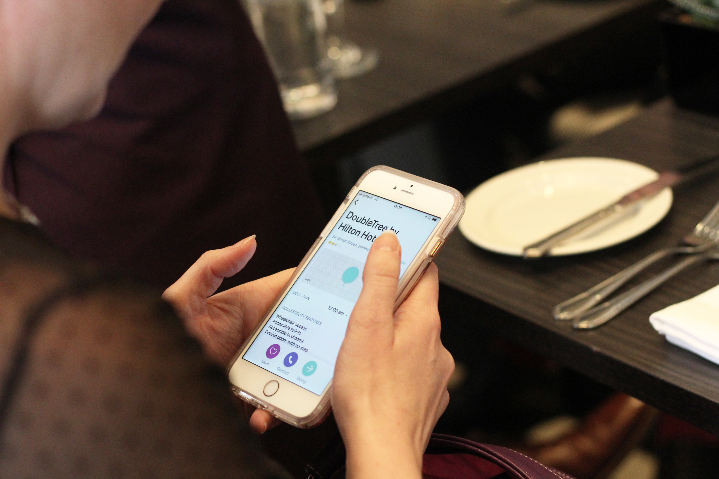 Michelle looking at the DoubleTree Hilton Edinburgh City Centre profile on the Welcome app