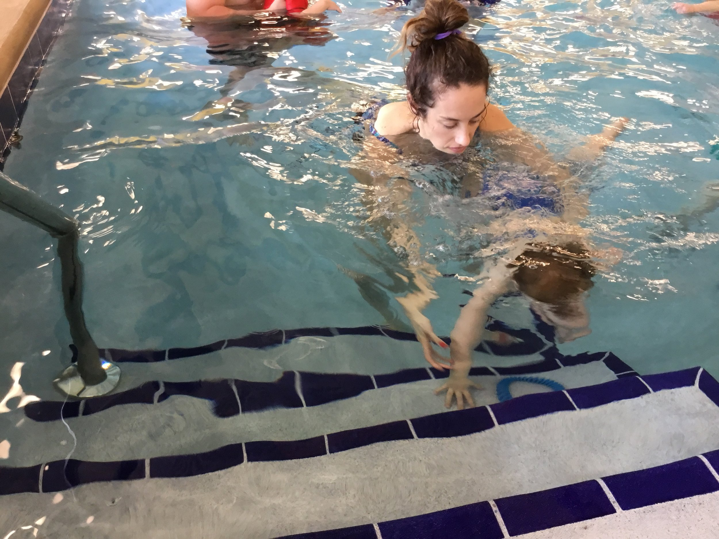 During each swim lesson, we work with the boys to grab the ring from a deeper step. I'm so proud of Andrew's progress!