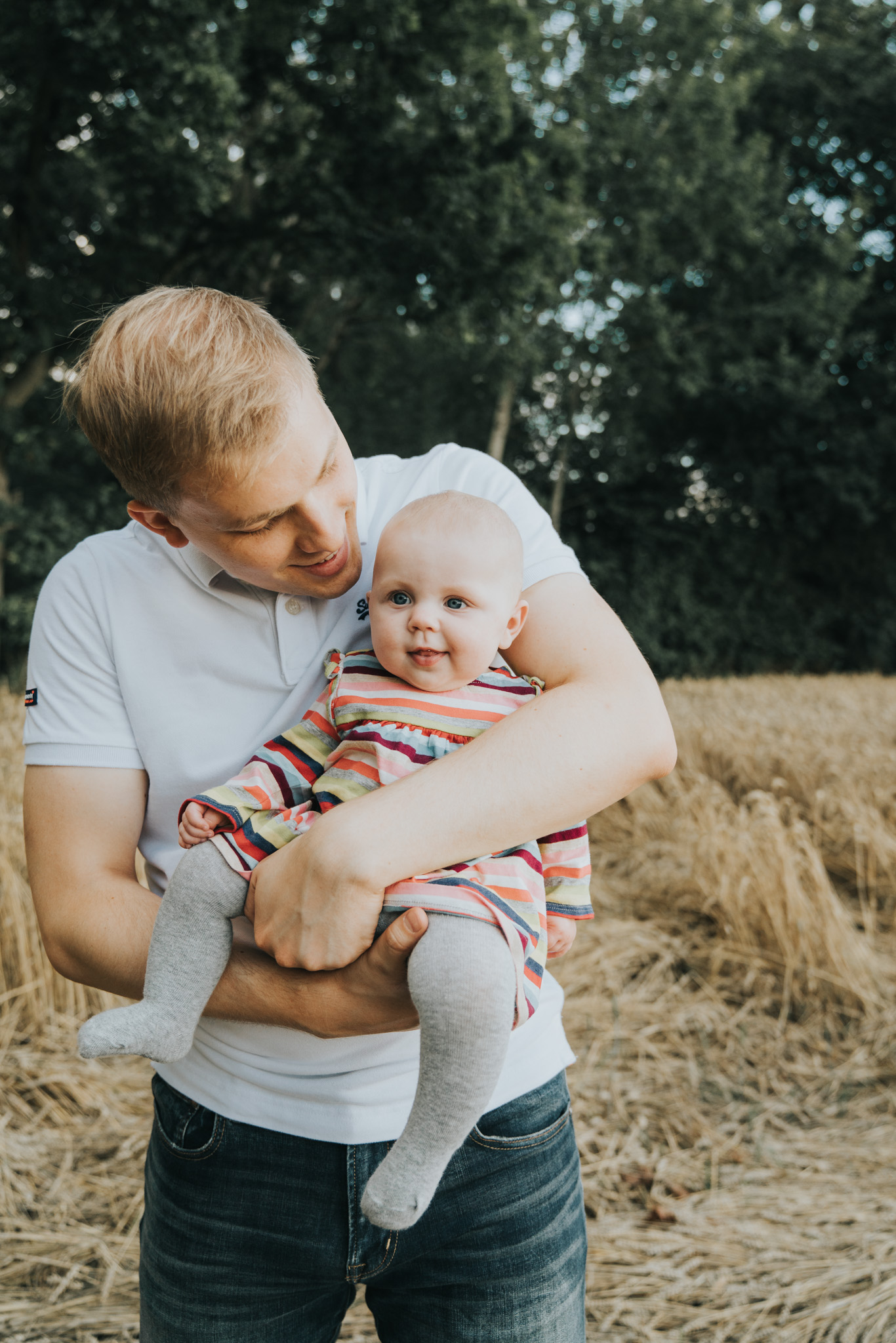 Portrait of young dad and baby girl in Suffolk