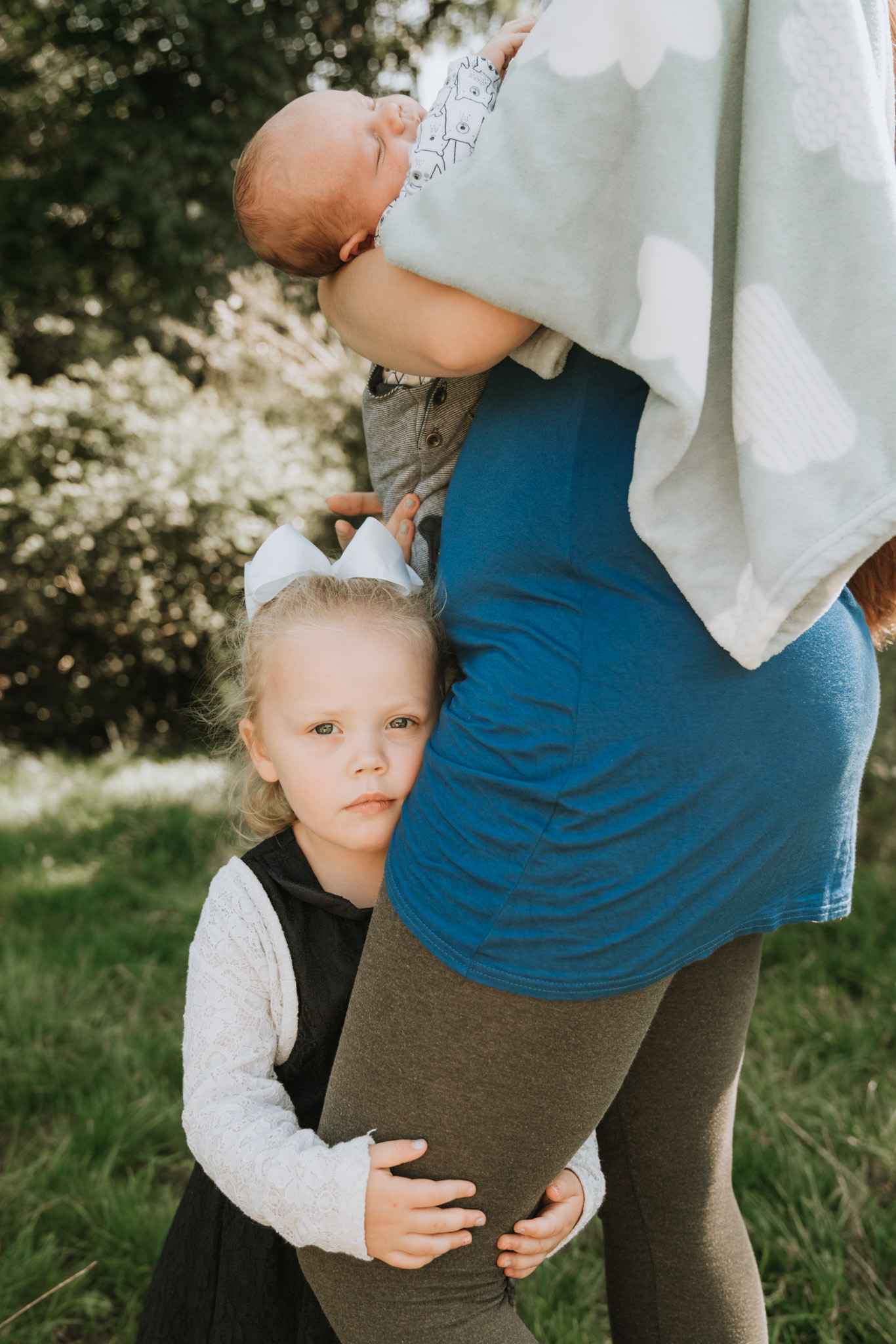 Toddler portrait with her newborn brother on location