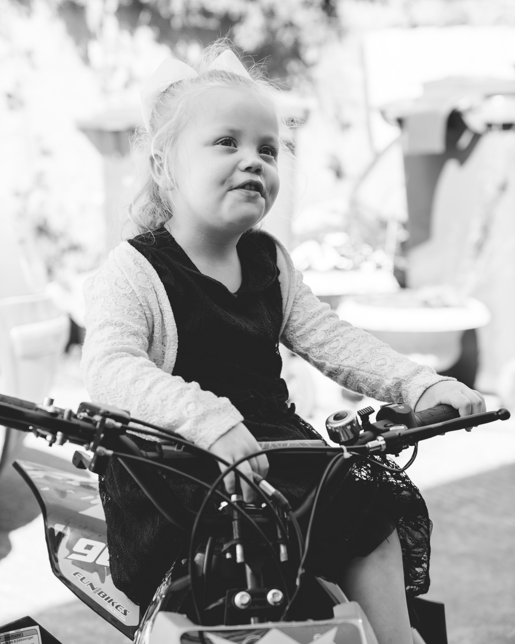 Four year old toddler girl on a quadbike