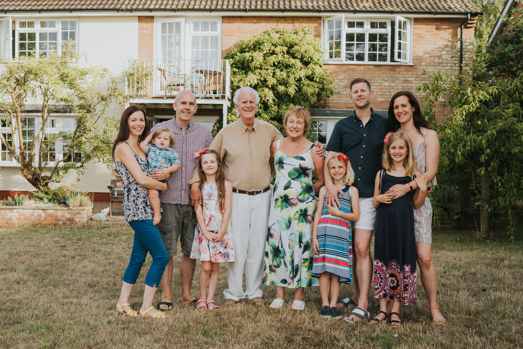 BARKER FAMILY - This year we had a special reunion. Our extended family was getting together for the first time in two years, and we wanted to capture it.We researched photographers and booked Grace as we loved her pictures and she was a local! She responded quickly to our original booking and had a really relaxed manner. She liked to chat personally which I loved and we spent ages on the phone so she could find out the type of photos we wanted, who was involved, the story behind them etc. I realise now how important this was to make the final outcome have real meaning.In addition, our price included all edited high and low res photos to usb. This had big appeal as we didn't want to limit our choice and make hard decisions at the end which you have to with many photographers nowadays.When she arrived she was calm and professional. Grace put everyone at ease. Sometimes taking our lead and sometimes directing us gently but clearly with loads of praise and laughs. Therefore she got the best out of old and young who had lots of different temperaments!! She also stayed over time without batting an eye lid.The result was gorgeous pictures that captured the heart of our family and the essence of the day, making new memories to look back on. I only wish we had done an all day session then we'd have even more!