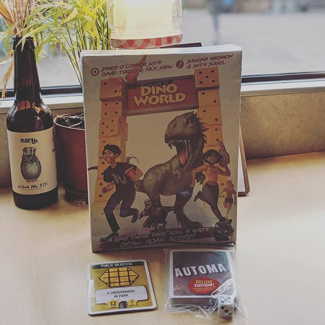 New game alert! Kickstarter from @alleycatgames arrived fresh this morning - if you like Jurassic Park you're going to love this roll and write #welcometodinoworld We've paired it with a Verbena Pale from @earth_tap1 beacuse, well, Verbs goes with everything! 🍺🦕🦖🎲✏️ #cakesandladders #cakesandladderscafe #cakesandladdersldn #cakesandladderslondon #boardgamegeek #boardgame #boardgamegeeks #boardgames #boardgamesofinstagram #secretlondon #london🇬🇧 #london #londonist #londoner #london_enthusiast #londonlife #woodgreen #hornsey #turnpikelane #palmersgreen #northlondon #greenlanes #cafe #boardgamecafe #allypally #crouchend #muswellhill #finsbury #boardgameaddict
