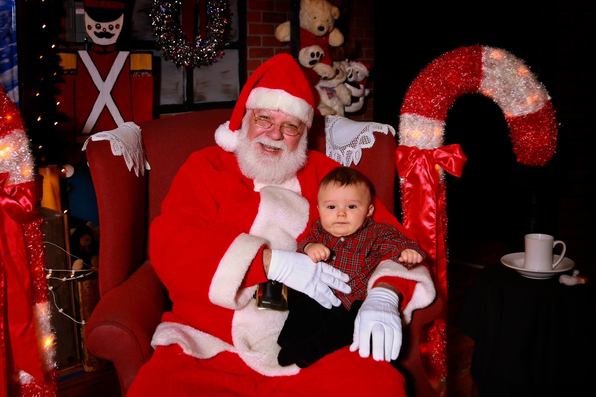 Image is an example of a photograph with santa. This will not be the backdrop that will be utilized the day of the event.