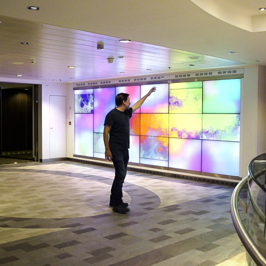 Ovation   This gesturally interactive digital art canvas allows passengers on board the Royal Caribbean's cruise ship, to paint on layers of color and change scenes just by waving their arms in the air.